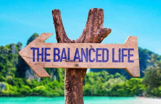 The Balance Life arrow with beach background