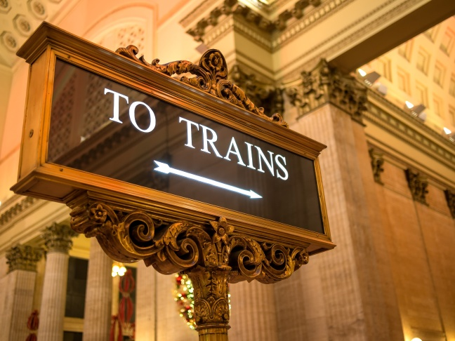 To Trains sign