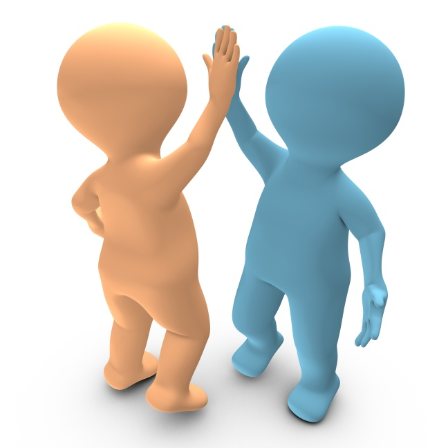 A high five between two persons that celebrate a success