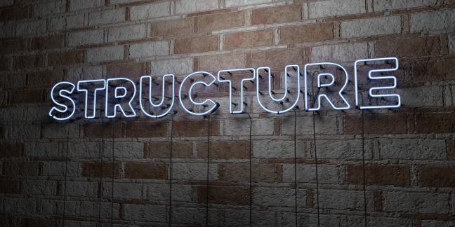 STRUCTURE - Glowing Neon Sign on stonework wall