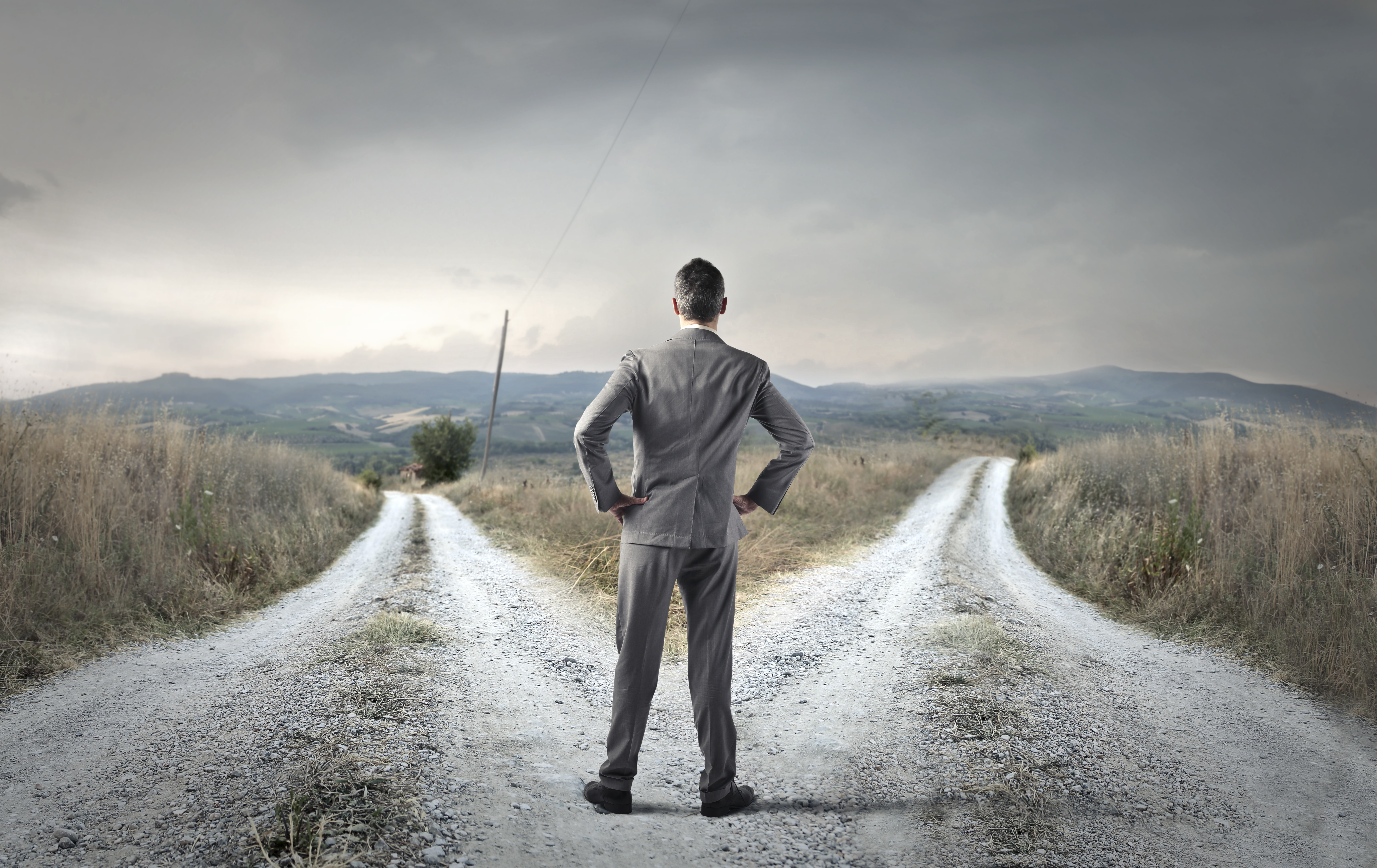Undecided businessman weighing his choice