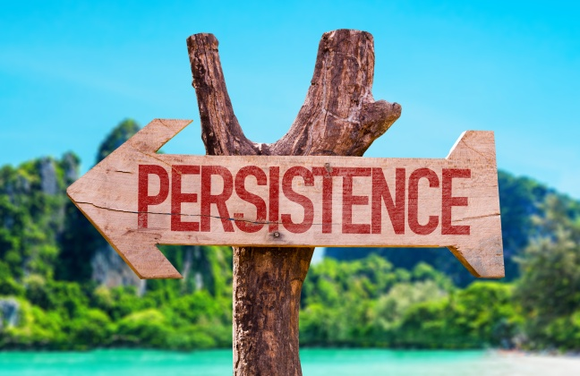 Persistence arrow with beach background