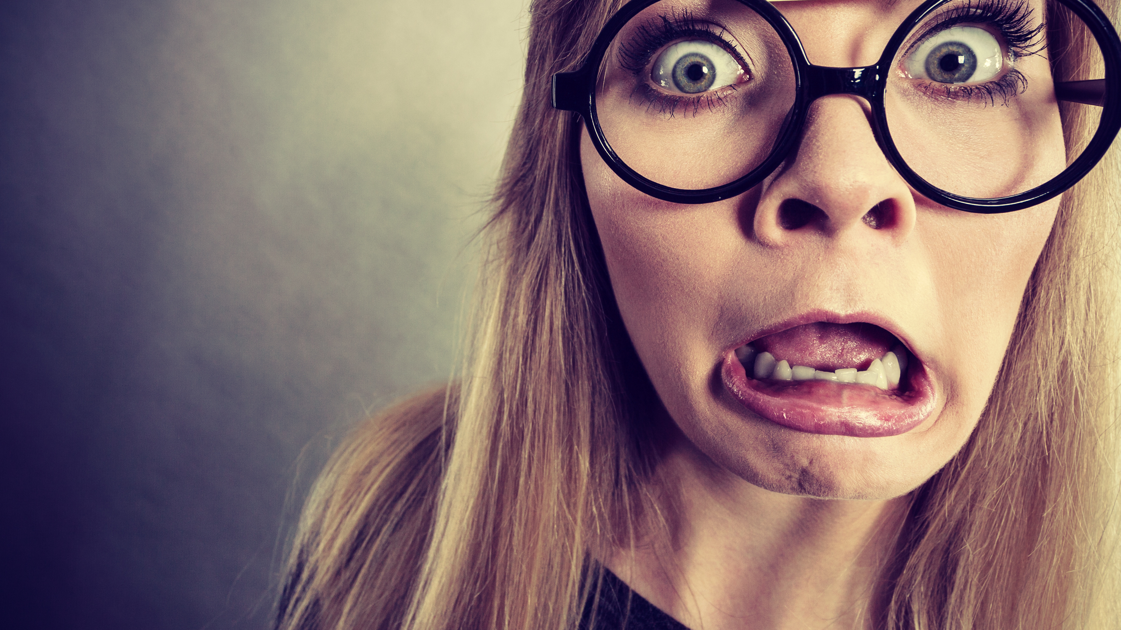 Closeup woman shocked face with eyeglasses