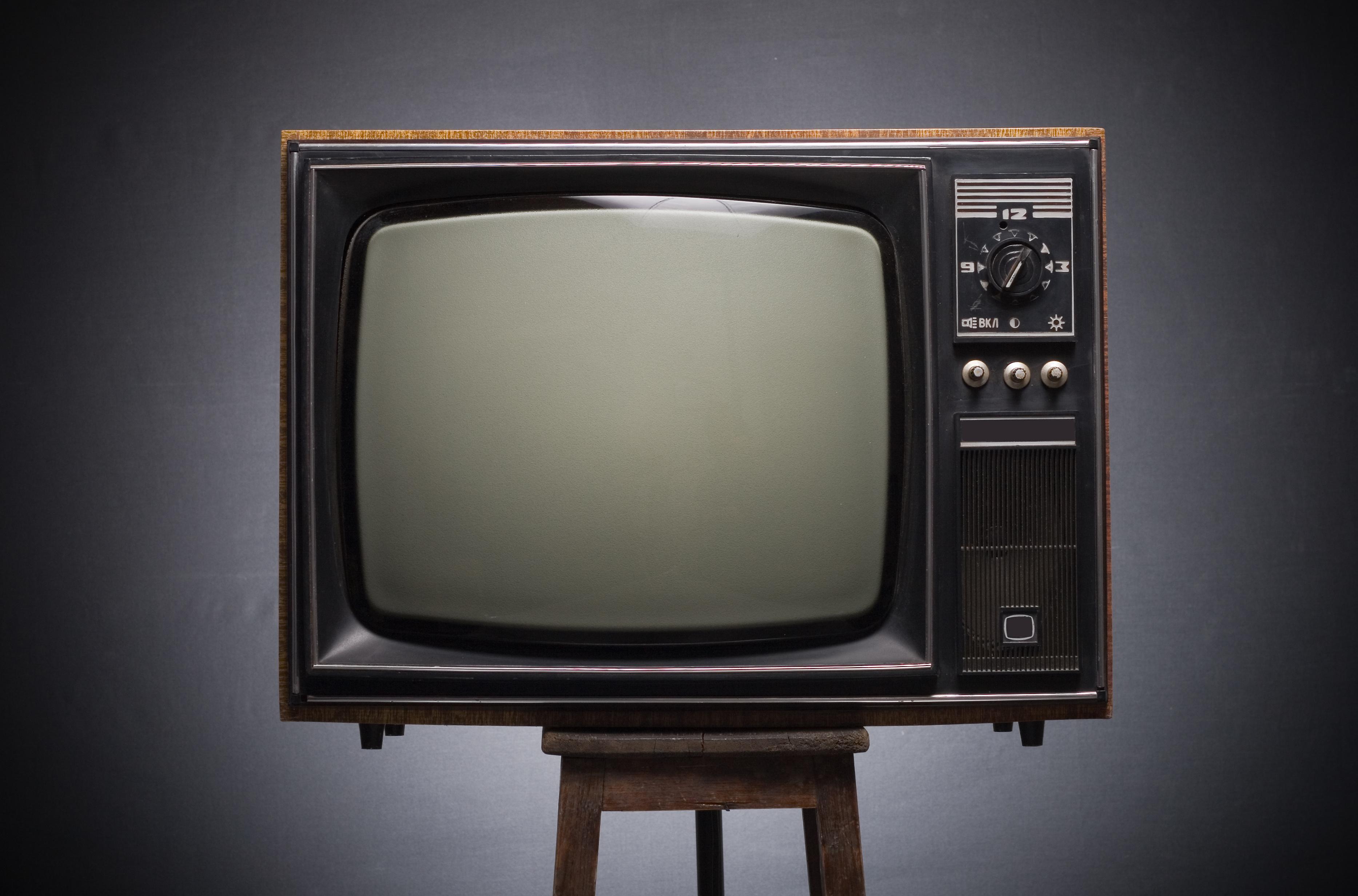 Retro TV on a dark background.