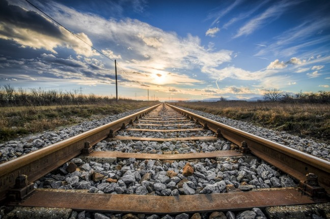 railroad tracks with scenic background
