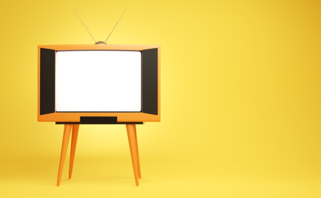 Retro orange tv receiver on the yellow background.