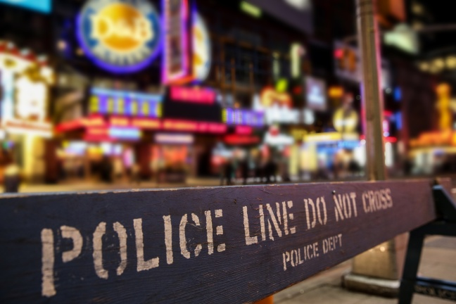 Police line crime scene in New York City with blurry background